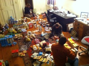 Zoe, Norah, and Chris beset in a sea of processed packages