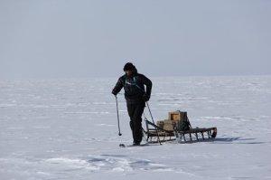Nate manhauling a 50 yr old wooden, Norwegian built Nansen sled at summit station.