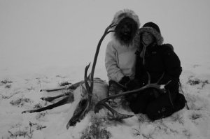 Zandra and Mike with their years supply (and our expeditions supply!) of subsistence harvest wild meat